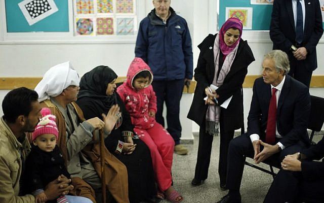 Middle East Quartet envoy Tony Blair (R) visits a UN-run school sheltering Palestinians, whose houses were destroyed by what they said was Israeli shelling during the 50-day war last summer, in Gaza City on February 15, 2015. (photo credit: AFP PHOTO / POOL / SUHAIB SALEM)