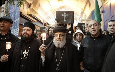 Christians take part in a symbolic funeral procession in Jerusalem's Old City on February 18, 2015, for the 21 Egyptian Coptic Christians beheaded by the Islamic State (IS) group on a Libyan beach. (photo credit: AFP PHOTO / AHMAD GHARABLI)