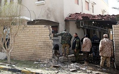Libyan security forces inspect the site of a bomb explosion at the entrance of the residence of the Iranian ambassador in the capital Tripoli on February 22, 2015. (Photo credit: AFP/STR)