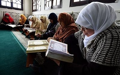 Mourshidates, female religious guides appointed by the Algerian religious affairs ministry to spread the good word of Islam and a message of tolerance, read the Koran, Islam's holy book, at the Ennidal mosque in the Algerian capital, Algiers, on February 22, 2015. (Photo credit: AFP/ FAROUK BATICHE)