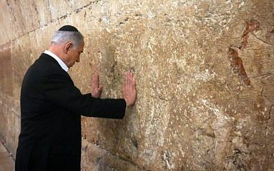 Prime Minister Benjamin Netanyahu prays at the Western Wall in the Old City of Jerusalem on February 28, 2015 (Photo credit: AFP/Pool/Marc Sellem)