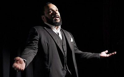 French comedian Dieudonne M'bala M'bala delivering a speech, January 15, 2012. (AFP/Patrick Kovarik)
