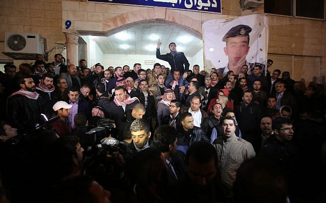 Supporters and family members of Jordanian pilot First Lieutenant Maoz al-Kasasbeh gather following his reported killing at the Karak tribal gathering chamber or Diwan, in the Jordanian capital Amman on February 3, 2015. (photo credit: AFP/STR)