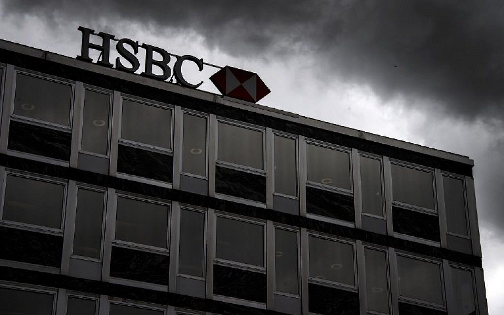 In this file picture taken on on June 14, 2013, clouds gather over a sign of HSBC private bank (Suisse) in the center of Geneva. (AFP/Fabrice Coffrini)