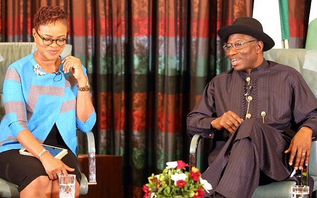Nigerian President Goodluck Jonathan (right) speaks, flanked by broadcaster and publisher Adesuwa Onyenokwe, during a nationally broadcast interview with journalists in Abuja on February 11, 2015.  (photo credit: AFP/Stringer)
