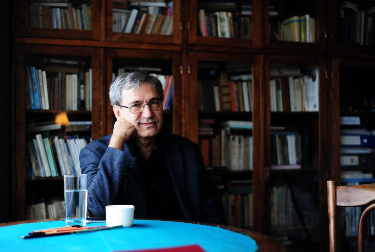 Turkish Nobel laureate author Orhan Pamuk works at his desk at his house in Istanbul, on Febuary 2, 2015. (photo credit: AFP/OZAN KOSE)