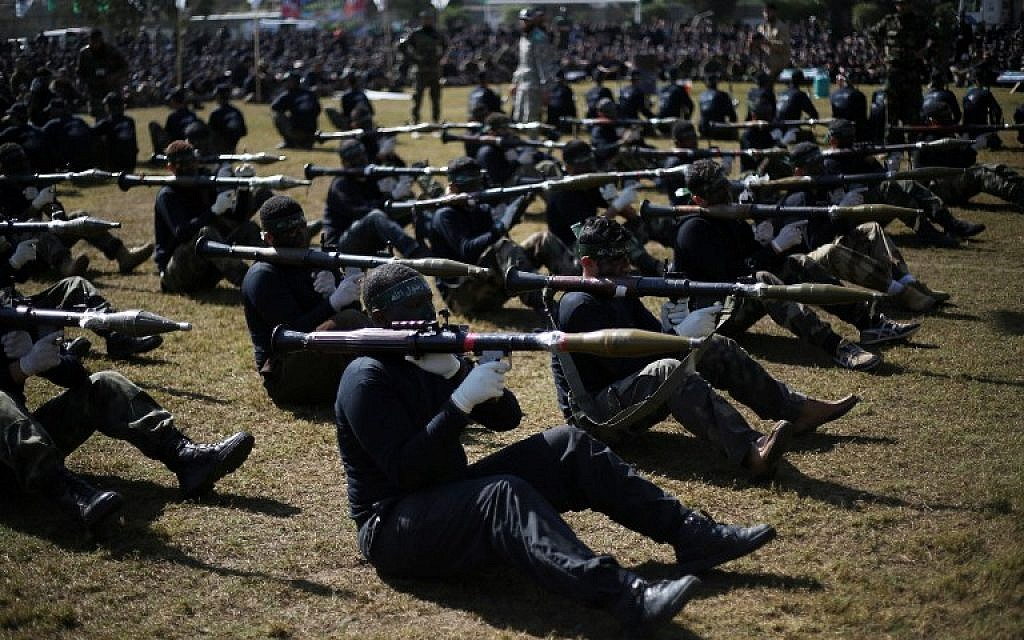 Palestinian youth show their skills during a graduation ceremony as part of a training camp run by the Hamas movement on January 29, 2015 in Khan Yunis, in the southern Gaza Strip. (AFP photo/Said Khatib)