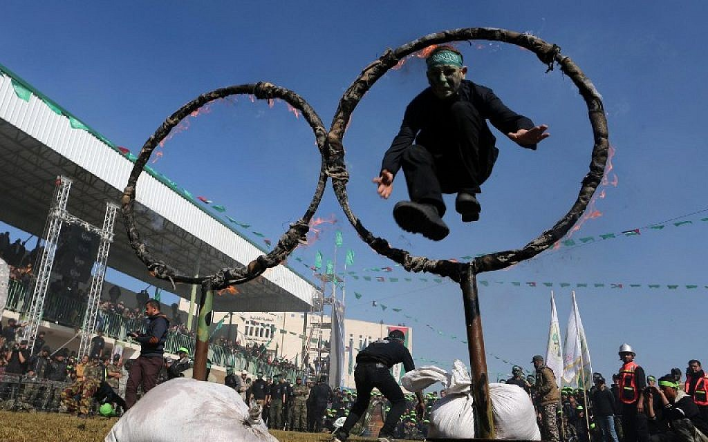 A file picture taken on January 29, 2015, shows Palestinian youth showing their skills during a graduation ceremony for a training camp run by the Hamas movement in Khan Yunis, in the southern Gaza Strip. (photo credit:  AFP PHOTO / SAID KHATIB)