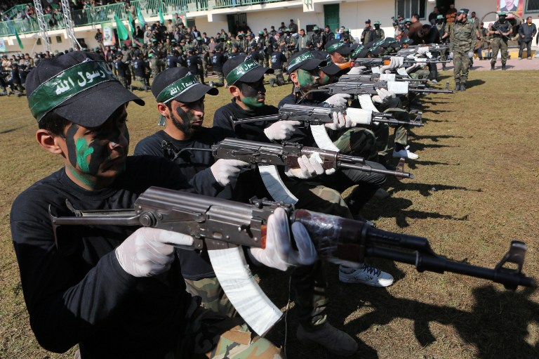 A file picture taken on January 29, 2015, shows Palestinian youth showing their skills during a graduation ceremony as part of a training camp run by the Hamas movement in Khan Yunis, in the southern Gaza Strip. (AFP photo/Said Khatib)