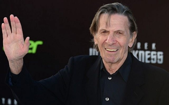 "Leonard Nimoy, who played the role of Spock in the original Star Trek television series, waves on arrival for the Los Angeles premiere of the movie 'Star Trek Into Darkness"" in Hollywood, California, in this May 14, 2013, file photo. (Photo credit: AFP/Frederic J. BROWN/FILES)"