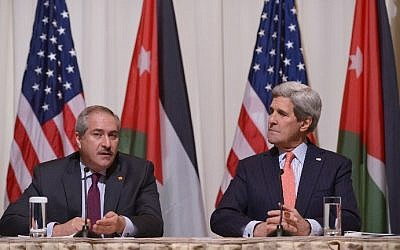 Jordanian Foreign Minister Nasser Judeh (L) speaks as US Secretary of State John Kerry looks on during a signing ceremony for a memorandum of understanding for US assistance to Jordan during a ceremony on February 3, 2015 at a hotel in Washington, DC. (photo credit: Mandel Ngan/AFP)