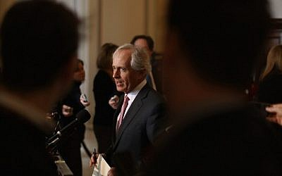 Sen. Bob Corker (R-TN) talks to reporters after attending a Senate bipartisan lunch in the Russell Senate Office Building on Capitol Hill February 4, 2015 in Washington, DC. (Photo credit: Chip Somodevilla/Getty Images/AFP)