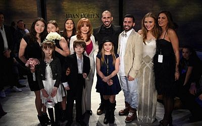 Lennon Stella and Maisy Stella attend the marriage of Israeli fashion designer, Idan Cohen (fourth from R) to his partner, Elad Borenstein (third from R) during Mercedes-Benz Fashion Week Fall 2015 at The Pavilion at Lincoln Center on February 14, 2015 in New York City. (photo credit: Andrew H. Walker/Getty Images/AFP)