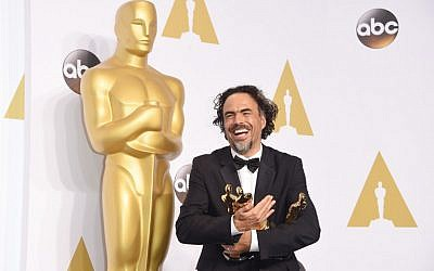 Director Alejandro Gonzalez Inarritu, winner of Best Original Screenplay, Best Director, and Best Motion Picture, for 'Birdman' poses in the press room during the 87th Annual Academy Awards at Loews Hollywood Hotel on February 22, 2015 in Hollywood, California. (photo credit: Jason Merritt/Getty Images/AFP)