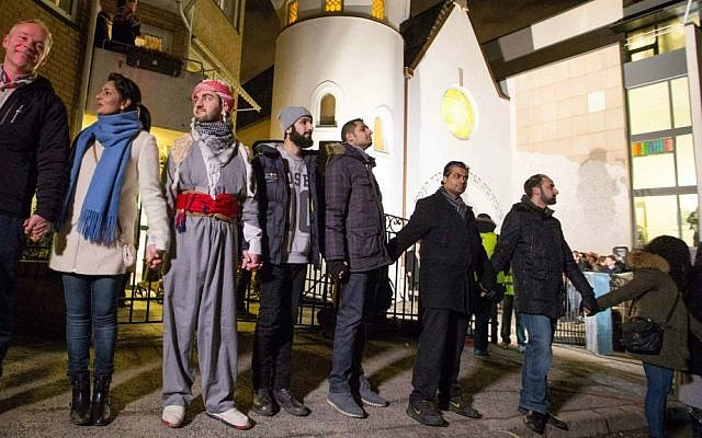"""More than 1,000 people formed a """"ring of peace"""" around the Norwegian capital's synagogue, an initiative taken by young Muslims in Norway after a series of attacks against Jews in Europe, in Oslo, Saturday, February 21 2015. (photo credit: AP/Hakon Mosvold Larsen/NTB Scanpix)"""