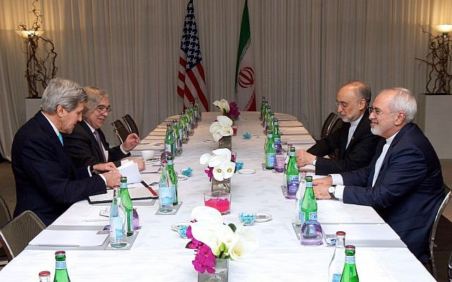 Secretary of State John Kerry and US Energy Secretary Ernest Moniz sit across from Iranian Foreign Minister Javad Zarif and Ali Akbar Salehi on February 22, 2015, in Geneva, Switzerland, before a four-way discussion about the future of Iran's nuclear program. (photo credit: US State Department)