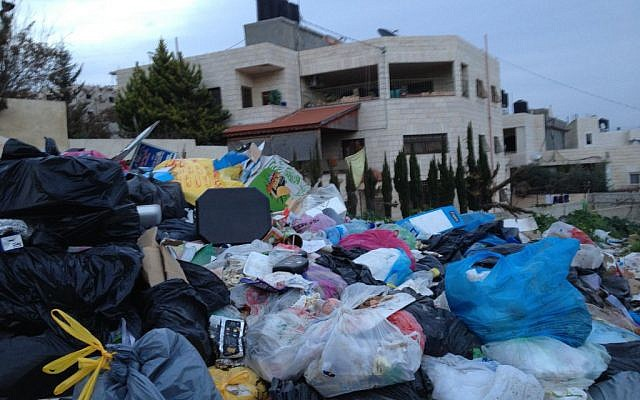 A mound of garbage in Ras Shehadah, a Jerusalem neighborhood located beyond the security barrier, January 26, 2015 (photo credit: Elhanan Miller/Times of Israel)