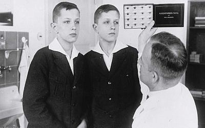 Dr. Otmar von Verschuer examines twins at the Kaiser Wilhelm Institute. As the head of the institute's Department for Human Heredity, Verschuer examined hundreds of pairs of twins to study whether criminality, feeble-mindedness, tuberculosis and cancer were inheritable. In 1927, he recommended the forced sterilization of the 'mentally and morally subnormal.' (Courtesy: United States Holocaust Memorial Museum)