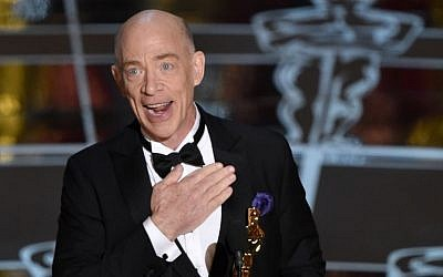 "J.K. Simmons accepts the award for best actor in a supporting role for ""Whiplash"" at the Oscars on Sunday, Feb. 22, 2015, at the Dolby Theatre in Los Angeles. (Photo credit: John Shearer/Invision/AP)"