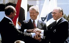 Egyptian president Anwar Sadat, US president Jimmy Carter, center, and Israeli prime minister Menachem Begin clasp hands on the north lawn of the White House as they sign the peace treaty between Egypt and Israel, March 26, 1979. (AP/Bob Daugherty)