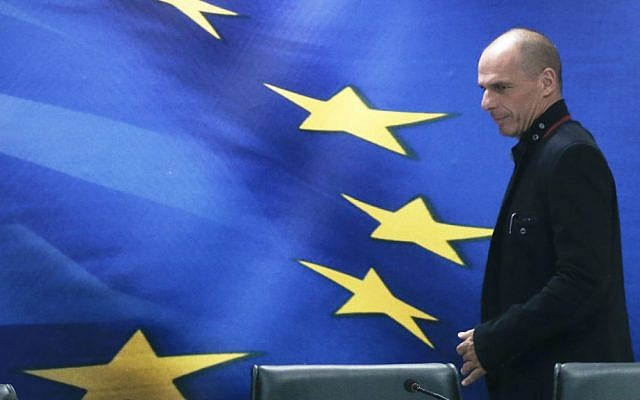 Greece's new Finance Minister Yanis Varoufakis arrives for a handover ceremony at the Finance Ministry in Athens, Wednesday, Jan. 28, 2015 (photo credit: Petros Giannakouris/AP Photo)