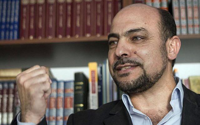 MK Masoud Ghanaim at his office in Sakhnin, January 26, 2015 (photo credit: AP/Dan Balilty)