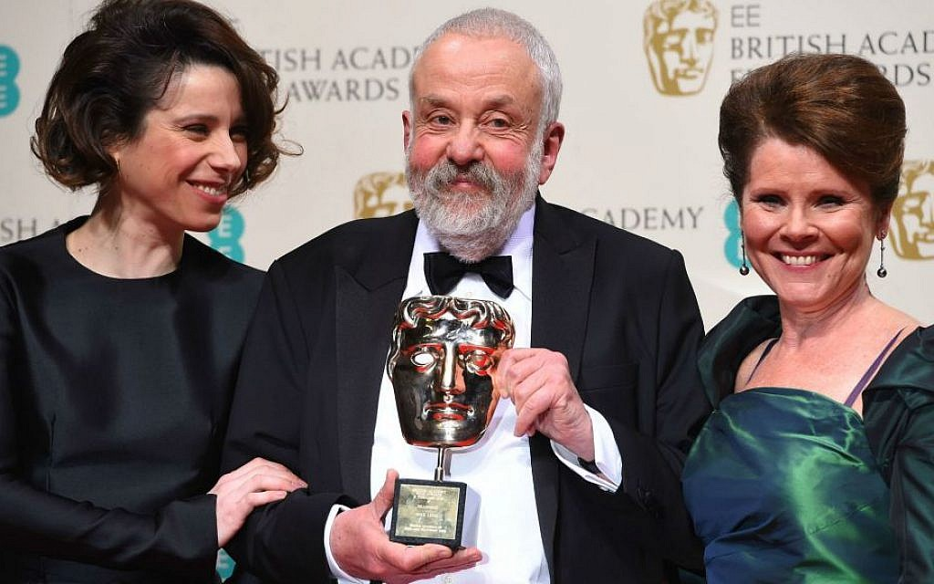 Sally Hawkins, left and Imelda Staunton, right, pose for photographers with Mike Leigh, winner the BAFTA Fellowship, in the winners room, during the British Academy Film and Television Awards 2015, at the Royal Opera House, in London, Sunday, Feb. 8, 2015. (Photo by Jonathan Short/Invision/AP)