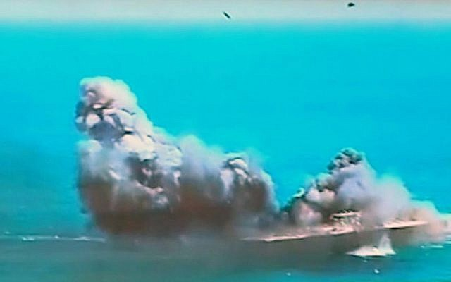 This image taken from Iranian state TV, shows footage of damage to a mock US aircraft carrier during large-scale naval and air defense drills by Iran's Revolutionary Guard, near the Strait of Hormuz, Iran, Wednesday, Feb. 25, 2015. The drill, named Great Prophet 9, was the first to involve a replica of a US carrier. (photo credit: AP Photo/Iran TV)