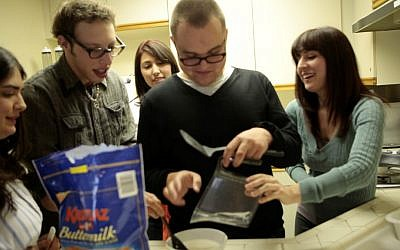 In their dorm kitchen, Advance LA residents cook together. (Help Group/JTA)