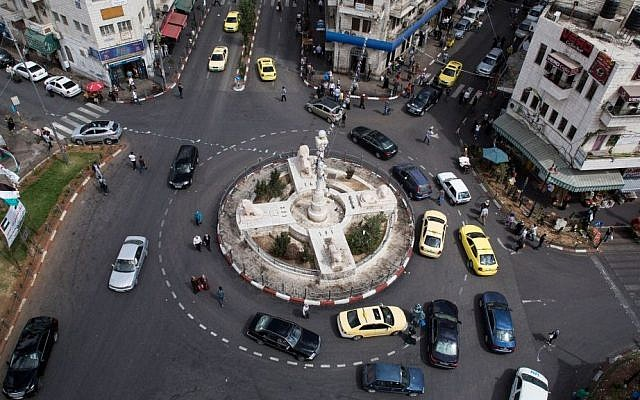 Illustrative photo: Cars passing through central Ramallah. (photo credit: Ilia Yefimovich/Getty Images/JTA)