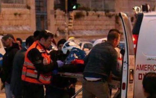 Paramedic Arie Yaffe treats a stabbing victim in Safra Square, February 22, 2015 (photo credit: Courtesy/United Hatzalah)