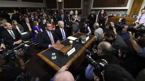 Ashton Carter, left, President Barack Obama's choice to head the Defense Department, left, and former Connecticut Sen. Joe Lieberman, sit on Capitol Hill in Washington, Wednesday, Feb. 4, 2015, prior to Carter testifying before the Senate Armed Services Committee hearing on his nomination to replace Chuck Hagel.  (photo credit: AP Photo/Susan Walsh)