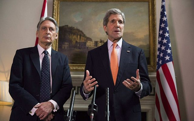Britain's Foreign Secretary Philip Hammond and US Secretary of State John Kerry, right, deliver a statement at a press conference in London, Saturday Feb, 21, 2015 (AP Photo/Neil Hall/Pool)
