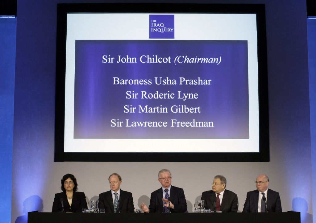 In this Thursday July 30, 2009 file photo, John Chilcot, center, the chairman of the Iraq Inquiry, sits with committee members Baroness Usha Prashar, left, Roderic Lyne, second left, Martin Gilbert, second right, and Lawrence Freedman at the QEII conference centre in London. (AP Photo/Matt Dunham, Pool, File)