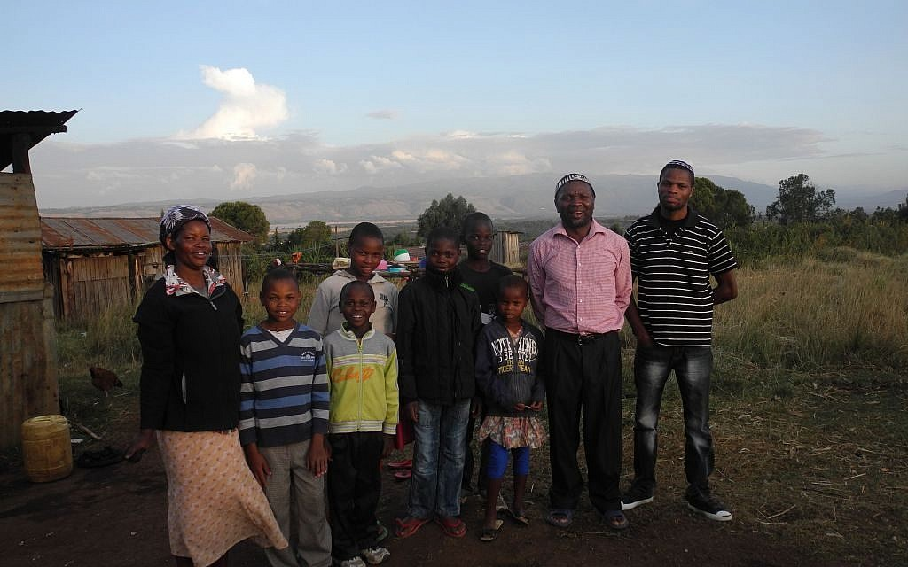 Yosef Njogu and Ruth with seven of their 13 children. They are the biggest family and make up about a quarter of the entire Jewish community in Kasuku. (Melanie Lidman/Times of Israel)