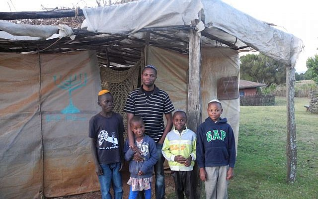 Yehuda Kimani and four of his siblings outside the synagogue in Kasuku, Kenya. (Melanie Lidman/Times of Israel)