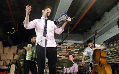 Gal Klein and members of the Klezmer fusion band Di Gasn Trio play at the YUNG YiDiSH museum at the Central Bus Station in Tel Aviv on Tu Bishvat. (photo: Avital Parness/Times of Israel)