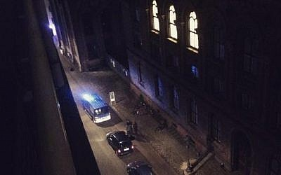 This photo, provided by Sebastian Zepeda, shows the scene near a synagogue where police reported a shooting in downtown Copenhagen, Denmark, Sunday, Feb. 15, 2015 (photo credit: AP Photo/Rasmus Thau Riddersh)