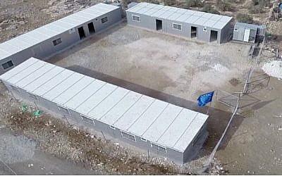 A still shot from footage taken by Israeli NGO Regavim showing a school in Area C bearing an EU flag. (Photo credit: Regavim)