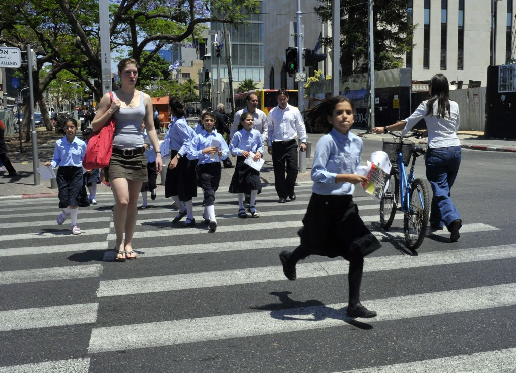 Haredi schoolgirls crossing the street in Tel Aviv (photo credit: Serge Attal/Flash 90)