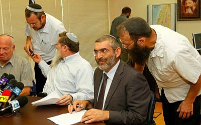 Former MK Michael Ben Ari, second from right, listening to his aide Baruch Marzel prior to a meeting with the National Union party, June 27, 2011. Left of Ben Ari sits MK Yaakov Katz. (photo credit: Miriam Alster/Flash90)