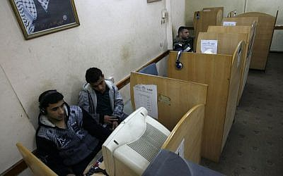 Illustrative photo of Palestinian men use a computer in the Gaza Strip on January 20, 2012. (Photo credit: Abed Rahim Khatib / Flash90)