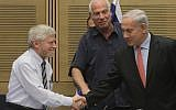 State Comptroller Yosef Shapira (left) shakes hands with Prime Minister Benjamin Netanyahu (right) in December 2012. (Miriam Alster/Flash90)