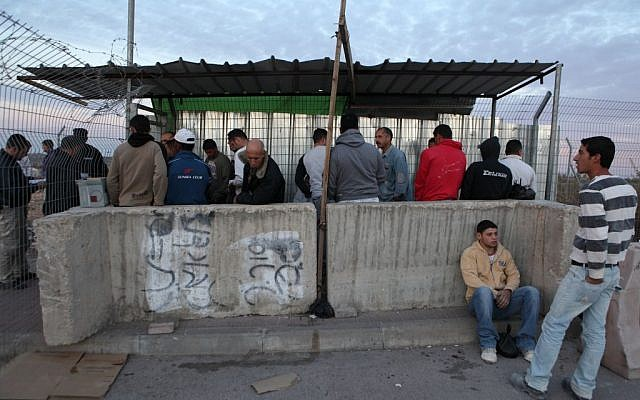 Palestinian construction workers wait to cross into Israel, at the checkpoint at the entrance to the West Bank Jewish settlement of Beitar Illit, November 28, 2010 (illustrative photo: Yaakov Naumi/Flash90)