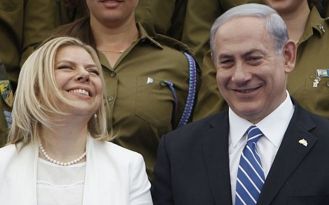 Israeli Prime Minsiter Benjamin Netanyahu and his wife Sara participate in a ceremony for outstanding soldiers as part of Israel's 66th Independence Day celebrations, at the President's residence in Jerusalem. May 06, 2014. (photo credit: Miriam Alster / Flash90, illustrative)