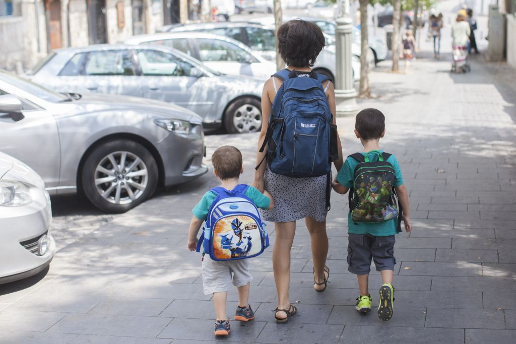 A mother and her two young sons walking to preschool together (photo credit: Yonatan Sindel/Flash 90)