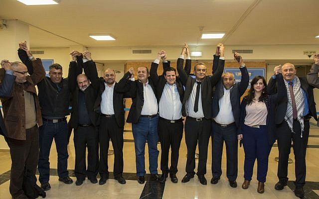 Members of the Joint List pose for a photo after presenting their list, January 28, 2015 (photo credit: Yonatan Sindel/Flash90)