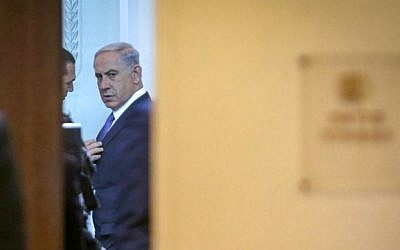 Prime Minister Benjamin Netanyahu seen at the weekly cabinet meeting at the Prime Minister Office in Jerusalem, February 01, 2015. (photo credit: Alex Kolomoisky/POOL)