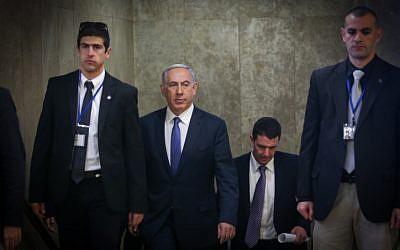 Prime Minister Benjamin Netanyahu arrives at the weekly cabinet meeting in Jerusalem on February 1, 2015. (photo credit: Alex Kolomoisky/POOL)