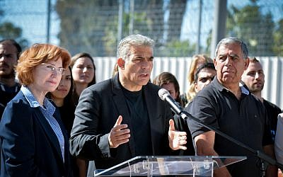 Yair Lapid with Yesh Atid members Yael German and Miki Levy announced a new legislation plan to fight corruption in Israeli politics outside the Ma'asiyahu Prison in Ramle, on February 2, 2015. (Flash90)